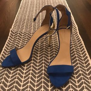 Blue suede and gold heeled high heels